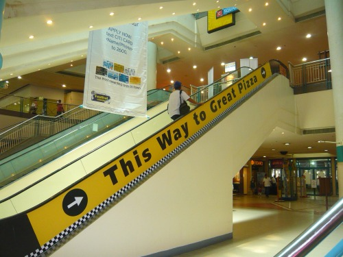 Wayfinding and Typographic Signs - escalator-to-great-pizza
