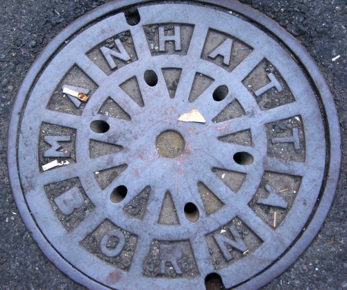 Wayfinding and Typographic Signs - manhattan-born-manhole-cover