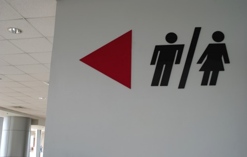 Wayfinding and Typographic Signs - male-female-this-way-please