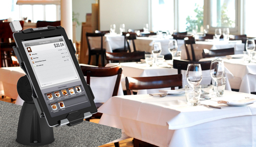 iPad mounted in a restaurant setting
