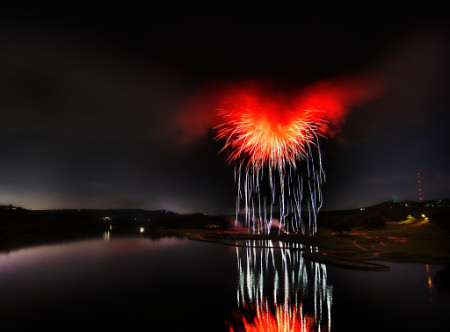 HDR Photos - Heart of Satan - What it looks like when fireworks explode inside of a storm cloud over a river