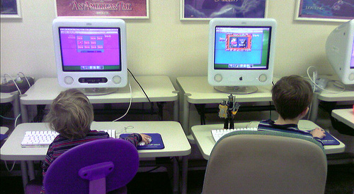 Two kids at computers