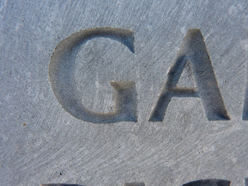 """G"" and ""A"" Carved In Limestone Without Infill Color"