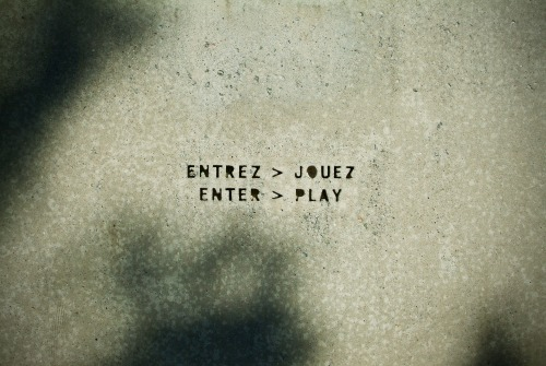 Wayfinding and Typographic Signs - enter-play-engraved-in-concrete