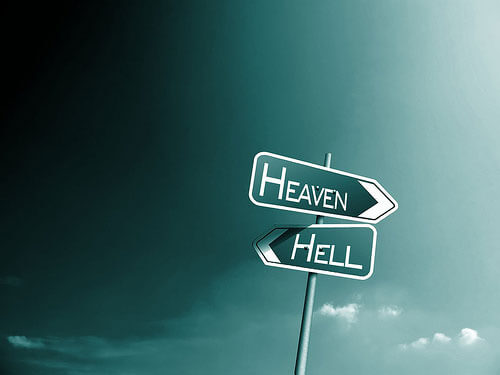 Photo of a road sign containing heaven and hell
