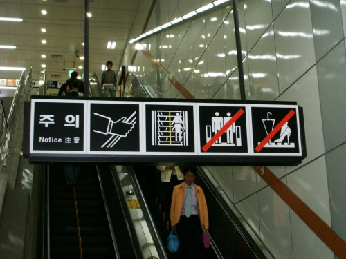 Wayfinding and Typographic Signs - notice-on-escalator