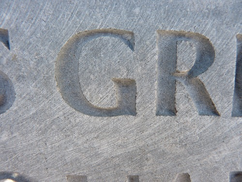 "Uppercase ""G"" and ""R"" Carved In Limestone"