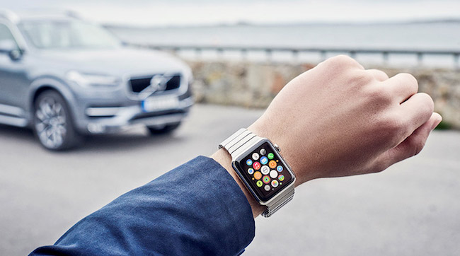 Apple watch on a wrist, helping someone find their car.