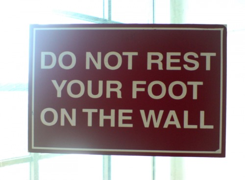 Wayfinding and Typographic Signs - do-not-rest-your-foot-on-the-wall