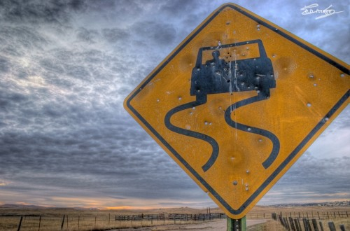 Road sign showing hazardous conditions