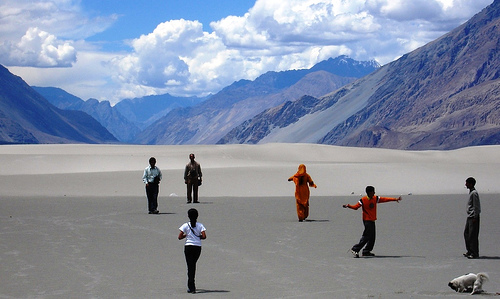 A Picture of a group of people on sand flats in the Himalayas