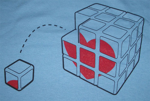 A Rubix cube style graphic with a heart logo and one cube piece fallen off