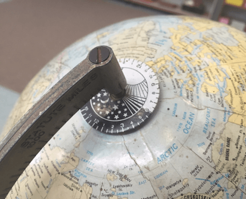 A globe with a 24-hour clock face