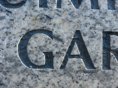 "Uppercase ""G"" And ""A"" Carved In Granite"
