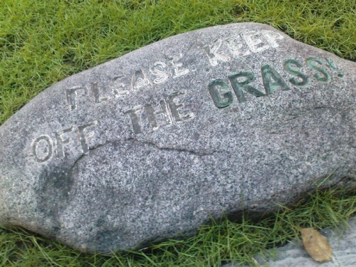 Wayfinding and Typographic Signs - embossed-keep-off-the-grass