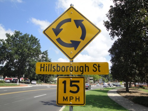 Wayfinding and Typographic Signs - roundabout-warning