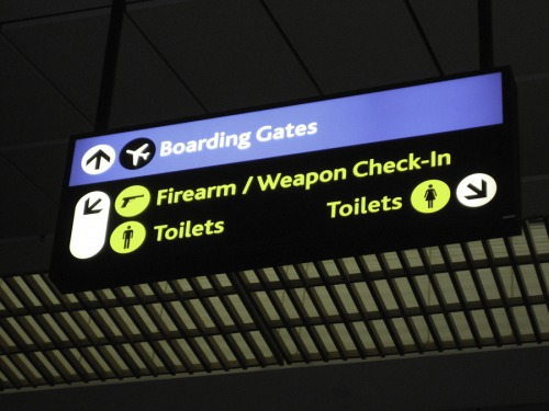 Wayfinding and Typographic Signs - johannesburg-airport-weapons-check-in