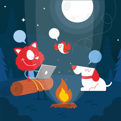 Topple sitting next to a campfire