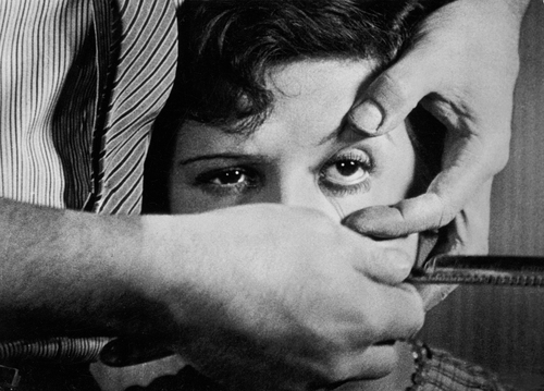 <em>A razor is drawn towards a woman's eye in this still from the film </em>Un Chien Andalou<em> by Salvador Dalí and Luis Buñuel, 1928.</em>