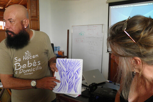 Artist and Design by Nature student Robert Barberena, with one of his pattern sketches at Casa de los Tres Mundos, Granada, Nicaragua, 2013.